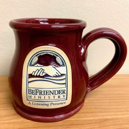 Burgandy mug with BeFriender Logo