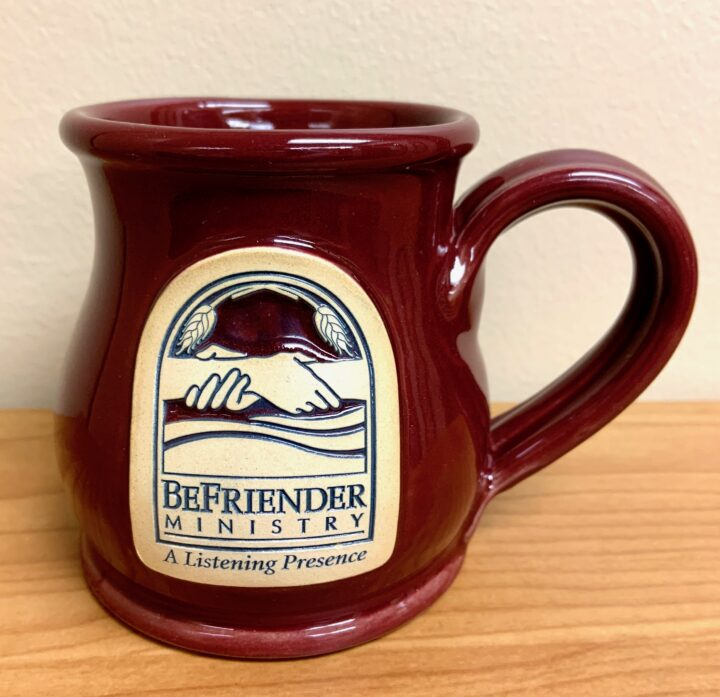 Burgandy mug with BeFriender Logo