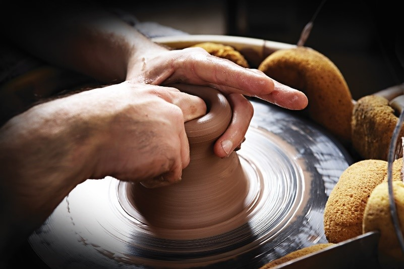 pottery being created at a potter's wheel