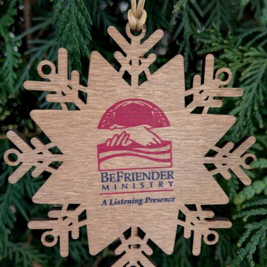 Wooden Christmas Ornament with the BeFriender logo on it
